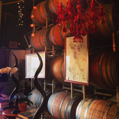 I loved the way the Jalama wines tasting room used the barrels to create art walls and added rustic elements like horns to compliment the red chandeliers.